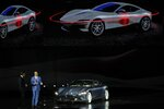 Ferrari Chief Marketing and Commercial Officer, Enrico Galliera, left, and Ferrari design senior vice President, Flavio Manzoni, present the new Ferrari Roma car, in Rome, Thursday, Nov. 14, 2019. Ferrari unveils a new sports coupe aimed at enticing entry-level buyers and competing with the Porsche 911, part of a complete refresh of its model lineup by 2022. (AP Photo/Gregorio Borgia)