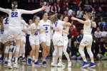 BYU players celebrate after defeating Auburn in a first-round game in the NCAA women's college basketball tournament in Stanford, Calif., Saturday, March 23, 2019. (AP Photo/Jeff Chiu)