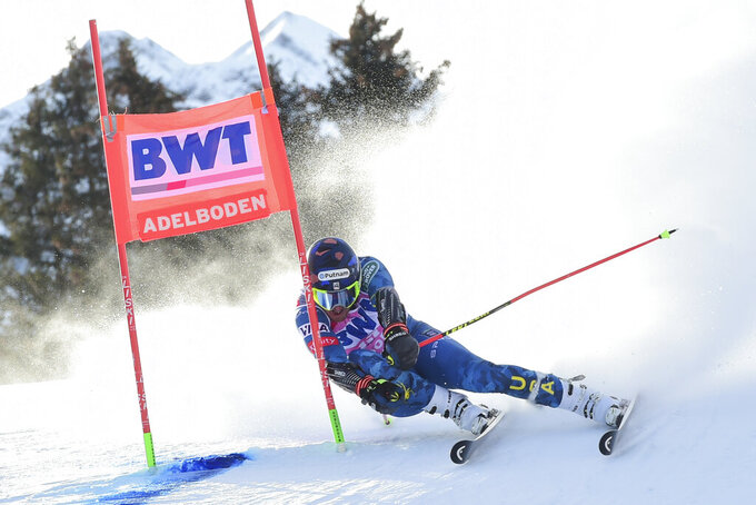 FILE - United States' Ted Ligety speeds down the course during an alpine ski, men's World Cup Giant slalom, in Adelboden, Switzerland, in this Saturday, Jan. 9, 2021, file photo. The World Pro Ski Tour starts the season this weekend with a pair of races in Steamboat Springs, Colorado. The person you're competing against could be a national team member, World Cup competitor, college standout, journeyman or even two-time Olympic champion Ted Ligety, who's been known to make an appearance in the field. (AP Photo/Marco Tacca, File)