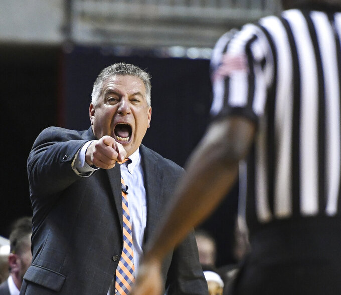 Auburn head coach Bruce Pearl talks to an official during the first half of an NCAA college basketball game against Arkansas Wednesday, Feb. 20, 2019, in Auburn, Ala. (AP Photo/Julie Bennett)