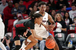 Houston guard Caleb Mills, front, drives around Connecticut guard Christian Vital (1) during the first half of an NCAA college basketball game Thursday, Jan. 23, 2020, in Houston. (AP Photo/Michael Wyke)