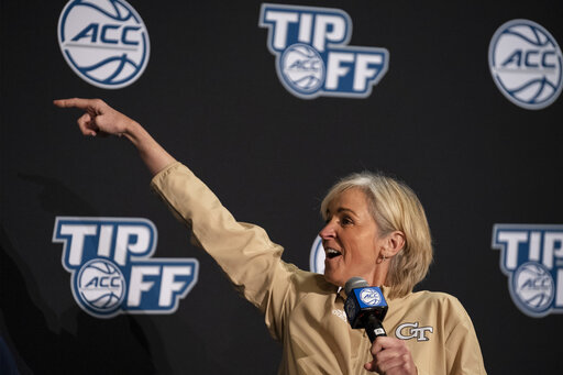 Georgia Tech head coach Nell Fortner smiles while gesturing during NCAA college basketball Atlantic Coast Conference media day, Wednesday, Oct. 13, 2021, in Charlotte, N.C. (AP Photo/Matt Kelley)