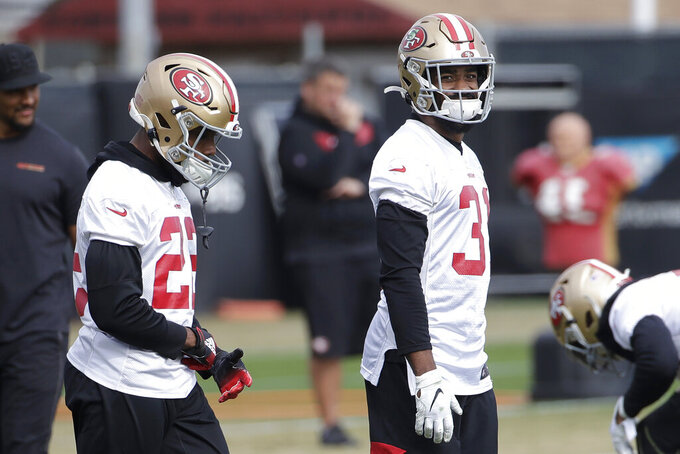 San Francisco 49ers running back Matt Breida, left, and running back Raheem Mostert warm up during practice at the team's NFL football training facility in Santa Clara, Calif., Thursday, Jan. 23, 2020. The 49ers will face the Kansas City Chiefs in Super Bowl 54. (AP Photo/Jeff Chiu)