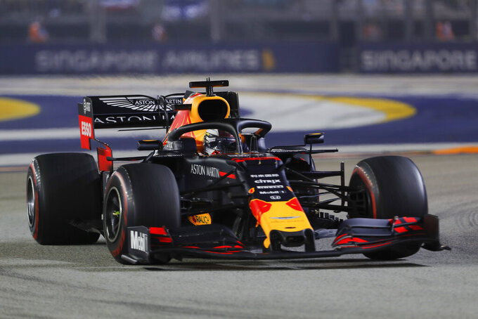 Red Bull driver Max Verstappen of the Netherlands steers his car during the Singapore Formula One Grand Prix, at the Marina Bay City Circuit in Singapore, Sunday, Sept. 22, 2019. (AP Photo/Lim Yong Teck)