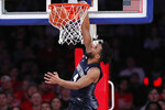 Georgetown guard Jagan Mosely (4) dunks during the second half of an NCAA college basketball game against St. John's, Sunday, Feb. 2, 2020, in New York. (AP Photo/Kathy Willens)