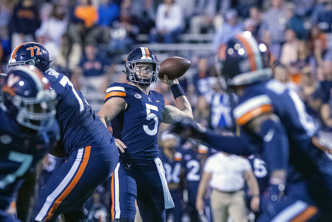 Virginia quarterback Brennan Armstrong (5) throws the ball during an NCAA college football game against Wake Forest Friday, Sept. 24, 2021, in Charlottesville, Va. (Erin Edgerton/The Daily Progress via AP)