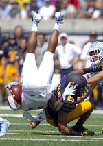 California's Malik Psalms (23) upends North Carolina wide receiver Anthony Ratliff-Williams during the first half of an NCAA college football game, Saturday, Sept. 1, 2018, in Berkeley, Calif. (AP Photo/D. Ross Cameron)