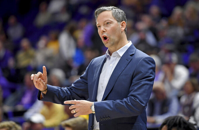 UMBC coach Ryan Odom shouts instructions to his players during the first half of an NCAA college basketball game against LSU on Tuesday, Nov. 19, 2019, in Baton Rouge, La. (AP Photo/Bill Feig)