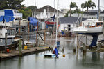 This Feb. 2018 photo provided by Ben Sheeran shows boats sit swamped by flooding from a king tide in Milford Marina, Auckland, New Zealand taken as part of the King Tides Auckland Initiative. Amateur scientists are whipping out their smartphones to document the effects of extreme high tides on shore lines from the United States to New Zealand, and by doing so are helping better predict what rising sea levels due to climate change will mean for coastal communities around the world. (Ben Sheeran/King Tides Auckland via AP)