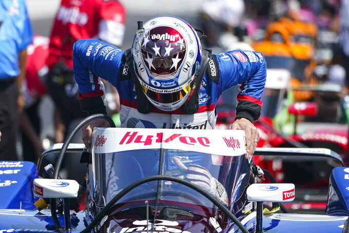 Graham Rahal climbs into his car during practice for the Indianapolis 500 auto race at Indianapolis Motor Speedway in Indianapolis, Thursday, May 20, 2021. (AP Photo/Michael Conroy)