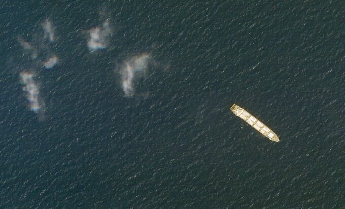 This Oct. 1, 2020, satellite photo from Planet Labs Inc. shows the Iranian cargo ship MV Saviz in the Red Sea off the coast of Yemen. The Iranian cargo ship, believed to be a base for the paramilitary Revolutionary Guard that has been anchored for years in the Red Sea off Yemen, has been attacked, Iranian state television acknowledged Wednesday, Wednesday, April 7, 2021. (Planet Labs Inc. via AP)