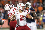 Nebraska quarterback Adrian Martinez (2) passes in the first half of an NCAA college football game against Illinois, Saturday, Sept. 21, 2019, in Champaign, Ill. (AP Photo/Holly Hart)