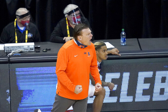 Illinois head coach Brad Underwood yells at his team during the second half of a first round NCAA college basketball tournament game against Drexel Friday, March 19, 2021, at the Indiana Farmers Coliseum in Indianapolis. Illinois won 78-49. (AP Photo/Charles Rex Arbogast)