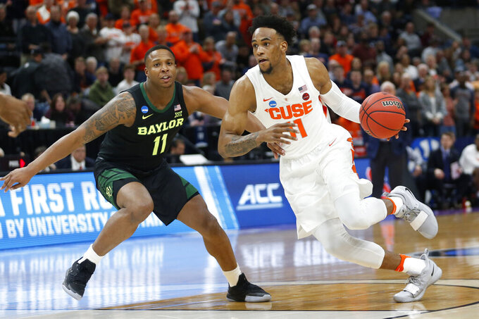 Syracuse forward Oshae Brissett (11) drives as Baylor guard Mark Vital (11) defends during the first half of a first-round game in the NCAA men's college basketball tournament Thursday, March 21, 2019, in Salt Lake City. (AP Photo/Rick Bowmer)
