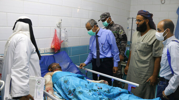 A man injured in a deadly missile and drone attack on Al-Anad Air Base in the province of Lahj, rests in a hospital in Lahj, Yemen, Sunday, Aug. 29, 2021. A missile and drone attack on a key military base in Yemen's south on Sunday killed at least 30 troops, a Yemeni military spokesman said. It was one of the deadliest attacks in the country's civil war in recent years. (AP Photo/Amro Quraish)