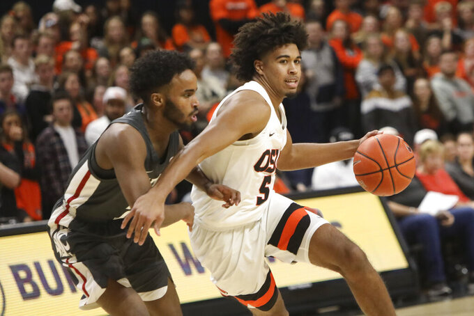 Oregon State's Ethan Thompson slides around Washington State's Ahmed Ali during the first half of an NCAA college basketball game in Corvallis, Ore., Thursday, Jan. 24, 2019. (AP Photo/Amanda Loman)