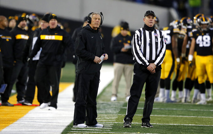 Iowa head coach Kirk Ferentz, left, watches a replay during the second half of an NCAA college football game against Northwestern, Saturday, Nov. 10, 2018, in Iowa City, Iowa. Northwestern won 14-10. (AP Photo/Charlie Neibergall)