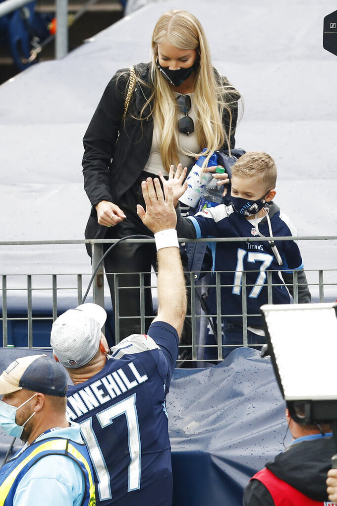 Tennessee Titans quarterback Ryan Tannehill (17) celebrates with his family after the Titans won in overtime against the Houston Texans in an NFL football game Sunday, Oct. 18, 2020, in Nashville, Tenn. The Titans won 42-36. (AP Photo/Wade Payne)