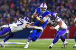 Buffalo Bills quarterback Tyree Jackson (6) is tackled, after a short run, by Minnesota Vikings defensive end Hercules Mata'afa, right, and linebacker Devante Downs (57) during the second half of an NFL preseason football game in Orchard Park, N.Y., Thursday, Aug. 29, 2019. (AP Photo/Adrian Kraus)
