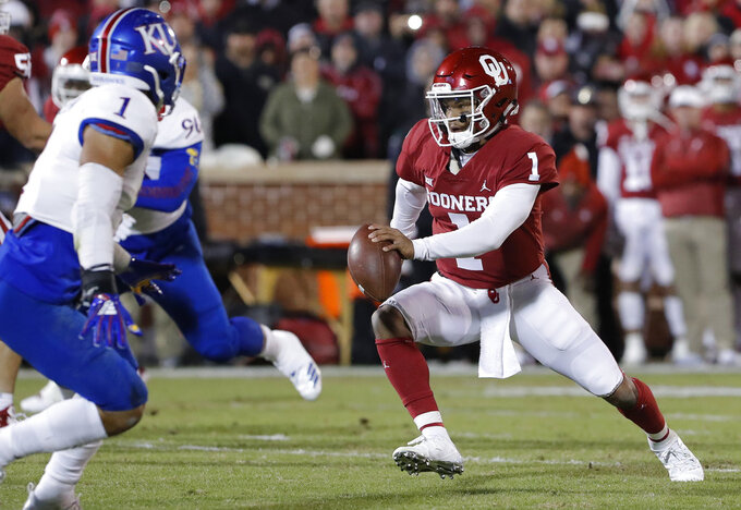 Oklahoma quarterback Kyler Murray (1) scrambles for a first down against Kansas during the first half of an NCAA college football game between Kansas and Oklahoma in Norman, Okla., Saturday, Nov. 17, 2018. (AP Photo/Alonzo Adams)