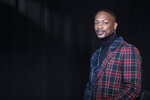 """This Oct. 10, 2019, photo shows fashion designer LaQuan Smith posing for a portrait in New York. Some see the self-trained Smith as a pioneer in pushing the fashion culture forward. The self-trained designer was rejected by both the Fashion Institute of Technology and the Parsons School of Design. He says he owes his success to staying true to himself and listening to his gut. Moet & Chandon named Smith one of its """"Nectar of the Culture"""" ambassadors on Tuesday. (AP Photo/Mary Altaffer)"""