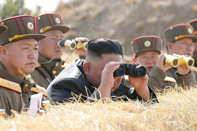 In this Friday, March 20, 2020, photo provided by the North Korean government, North Korean leader Kim Jong Un supervises an artillery firing competition between army units in the country's west in North Korea. Independent journalists were not given access to cover the event depicted in this image distributed by the North Korean government. The content of this image is as provided and cannot be independently verified. (Korean Central News Agency/Korea News Service via AP)