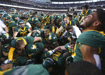 Baylor players mob Baylor running back JaMycal Hasty after his game winning touchdown in overtime against Texas Tech after a NCAA college football game, Saturday, Oct. 12, 2019, in Waco, Texas. Baylor won 33-30. (Rod Aydelotte/Waco Tribune Herald via AP)