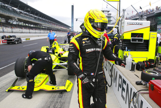 Simon Pagenaud, of France, walks away from his car after the final practice session for the Indianapolis 500 IndyCar auto race at Indianapolis Motor Speedway, Friday, May 24, 2019, in Indianapolis. (AP Photo/R Brent Smith)