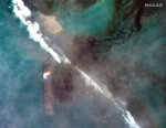 """In this satellite image provided by 2020 Maxar Technologies on Friday, Aug. 7, 2020, an aerial view of oil leaking from the MV Wakashio, a bulk carrier ship that recently ran aground off the southeast coast of Mauritius. The prime minister of Mauritius says the government is appealing to France for help with a brewing environmental disaster after a ship that ran aground almost two weeks ago off the Indian Ocean island nation began leaking oil. Prime Minister Pravind Jugnauth said Friday that the leak """"represents a danger for Mauritius"""