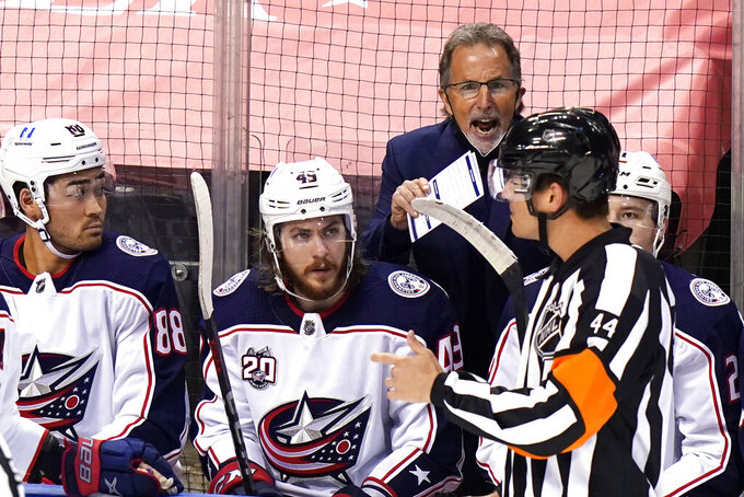 Columbus Blue Jackets head coach John Tortorella shouts at an official after a fight between Columbus Blue Jackets' s Gavin Bayreuther and Florida Panthers' Sam Bennett during the second period of an NHL hockey game, Monday, April 19, 2021, in Sunrise, Fla. (AP Photo/Lynne Sladky)