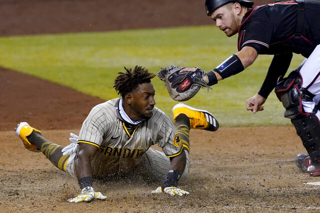 San Diego Padres' Jorge Mateo is tagged out by Arizona Diamondbacks catcher Carson Kelly for the final out of the game during the ninth inning of a baseball game Saturday, Aug. 15, 2020, in Phoenix.The Diamondbacks won 7-6. (AP Photo/Matt York)