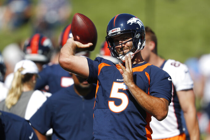 Denver Broncos quarterback Joe Flacco throws a pass during drills at the team's NFL football training camp Friday, July 19, 2019, in Englewood, Colo. (AP Photo/David Zalubowski)