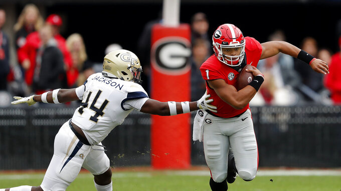 Georgia quarterback Justin Fields (1) breaks away from Georgia Tech linebacker Quez Jackson (44) during the second half of an NCAA college football game Saturday, Nov. 24, 2018, in Athens, Ga. Georgia won 45-21. (AP Photo/John Bazemore)