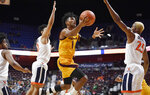 Arizona State's Remy Martin, center, shoots between Virginia's Kihei Clark, left, and Virginia's Mamadi Diakite, right, during the first half of an NCAA college basketball game, Sunday, Nov. 24, 2019, in Uncasville, Conn. (AP Photo/Jessica Hill)