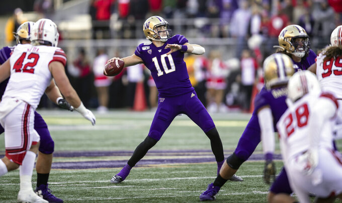Washington quarterback Jacob Eason (10) passes the ball during the first half of an NCAA college football game against Utah, Saturday, Nov. 2, 2019, in Seattle. (AP Photo/Stephen Brashear)