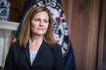 Judge Amy Coney Barrett, President Donald Trumps nominee for the U.S. Supreme Court, meets with Sen. Shelley Moore Capito, R-W.Va., not shown, on Capitol Hill in Washington, Wednesday, Sept. 30, . (Sarah Silbiger/Pool via AP)