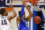 BYU forward Yoeli Childs (23) dunks next to Pepperdine forward Kessler Edwards (15) during the first half of an NCAA college basketball game Saturday, Feb. 29, 2020, in Malibu, Calif. (AP Photo/Ringo H.W. Chiu)