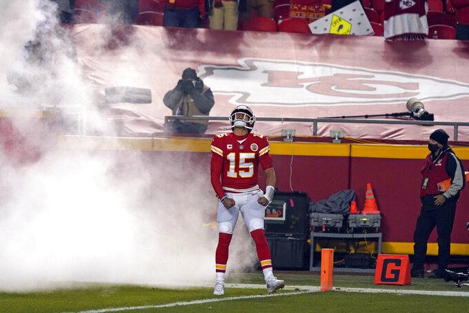 Kansas City Chiefs quarterback Patrick Mahomes runs onto the field before the AFC championship NFL football game against the Buffalo Bills, Sunday, Jan. 24, 2021, in Kansas City, Mo. (AP Photo/Jeff Roberson)