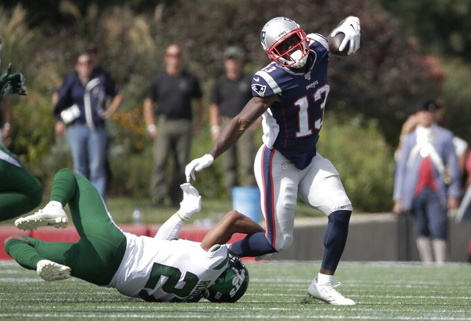 New York Jets cornerback Darryl Roberts, left, tackles New England Patriots wide receiver Phillip Dorsett in the first half of an NFL football game, Sunday, Sept. 22, 2019, in Foxborough, Mass. (AP Photo/Elise Amendola)