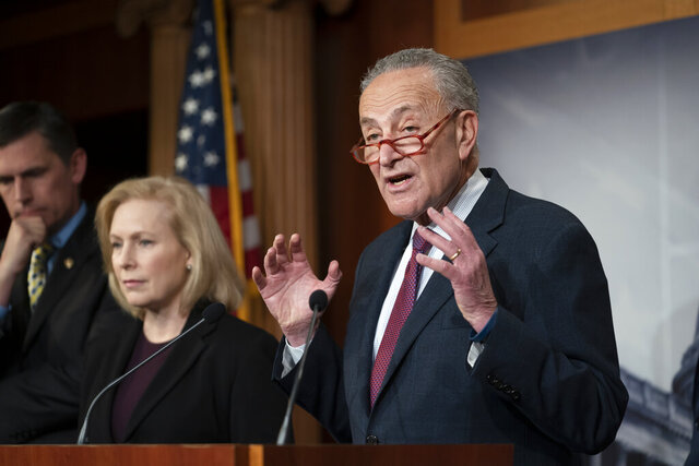 Senate Minority Leader Chuck Schumer, D-N.Y., joined from left by Sen. Martin Heinrich, D-N.M., and Sen. Kirsten Gillibrand, D-N.Y., talks to reporters about the impeachment trial of President Donald Trump on charges of abuse of power and obstruction of Congress, in Washington, Friday, Jan. 24, 2020. (AP Photo/J. Scott Applewhite)