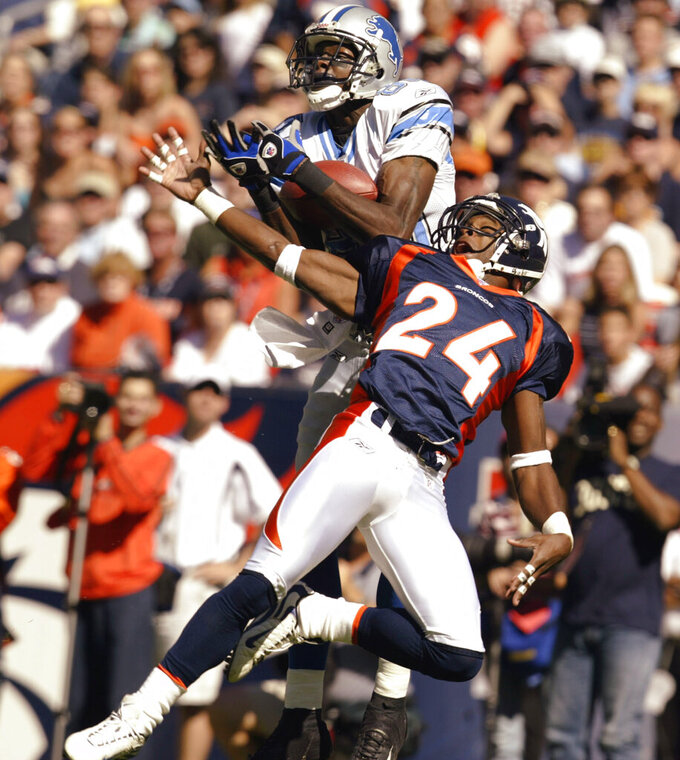 File-This Sept. 28, 2003 file photo shows Detroit Lions wide receiver Charles Rogers (80) pulling in a 33-yard touchdown pass as Denver Broncos Deltha O'Neal (24) tries to defend in the first quarter in Denver. Former NFL star O'Neal has been charged with felony drunken driving in connection with an August high-speed crash that seriously injured him and a passenger, Florida court records show.  O'Neal, 42, had a blood-alcohol level of 0.16 after the Aug. 7 crash that left the former Denver Broncos and Cincinnati Bengals cornerback with a concussion, broken ankle and internal injuries, according to a Palm Beach County arrest affidavit made public this week. That blood-alcohol level is twice the legal limit for driving in Florida.  (AP Photo/Jack Dempsey, File)