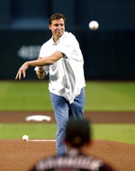 Arizona Diamondbacks Hall of Fame pitcher Randy Johnson throws out the first pitch prior to a baseball game between the Diamondbacks and San Francisco Giants on Saturday, May 18, 2019, in Phoenix. The Diamondbacks were marking the 15th anniversary of Johnson's perfect game against the Atlanta Braves. (AP Photo/Ralph Freso)