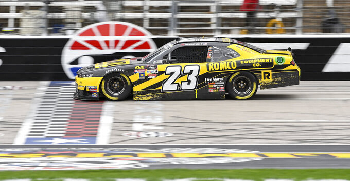 Driver John Hunter Nemechek races down the front stretch during qualifying for a NASCAR auto race at Texas Motor Speedway, Saturday, March 30, 2019, in Fort Worth, Texas. (AP Photo/Larry Papke)