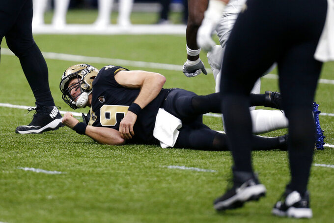 New Orleans Saints quarterback Drew Brees (9) lies on the turf in the first half of an NFL football game against the Indianapolis Colts in New Orleans, Monday, Dec. 16, 2019. (AP Photo/Butch Dill)