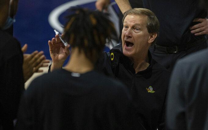 Oregon head coach Dana Altman talks with his players during a timeout in an NCAA college basketball game against Arizona, Saturday, Feb. 13, 2021, in Tucson, Ariz. (Josh Galemore/Arizona Daily Star via AP)