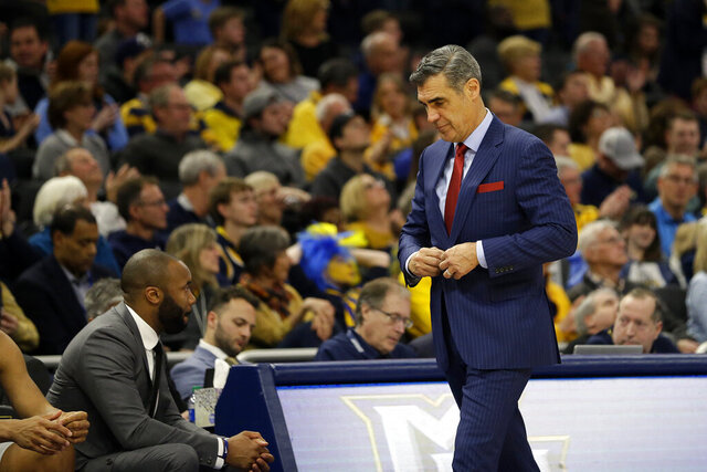 Villanova head coach Jay Wright buttons his suit jacket during the second half of an NCAA college basketball game against Marquette, Saturday, Jan. 4, 2020, in Milwaukee. (AP Photo/Aaron Gash)