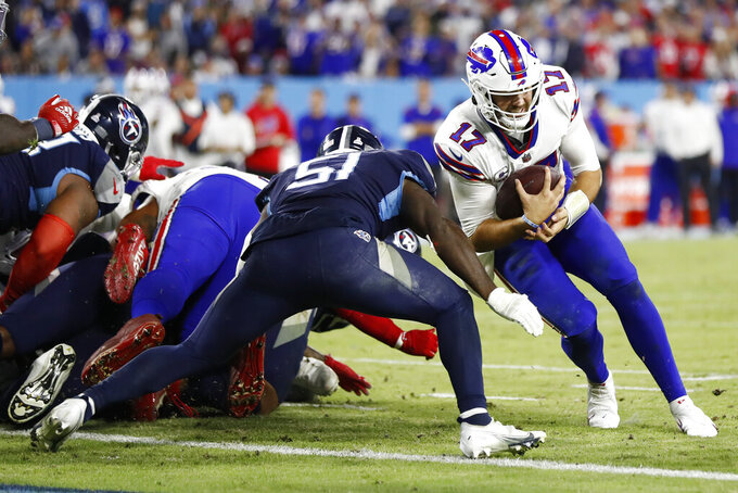 Buffalo Bills quarterback Josh Allen (17) is stopped short of the goal line by Tennessee Titans linebacker David Long Jr. (51) in the second half of an NFL football game Monday, Oct. 18, 2021, in Nashville, Tenn. (AP Photo/Wade Payne)