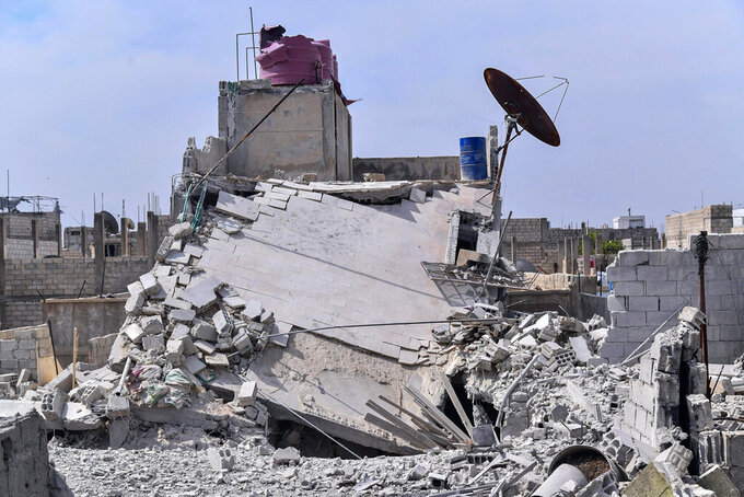 This photo released by the Syrian official news agency SANA, shows the rubble of a house that according to the Syrian authorities was attacked by an Israeli airstrike, in the Damascus suburbs of Hajira, Syria, Monday, April 27, 2020. The Syrian military and state media said Monday that Israeli warplanes flying over Lebanon fired missiles toward areas near the Syrian capital of Damascus, killing three civilians. An opposition war monitor says four Iran-backed fighters were also killed. The military says Syrian air defenses shot some of the missiles down. The reports said the attack happened around dawn on Monday. (SANA via AP)