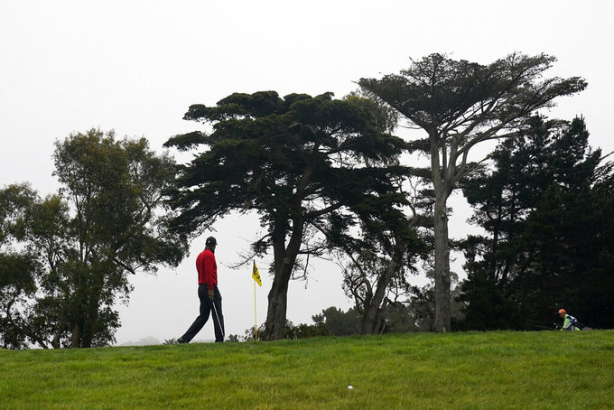 Tiger Woods walks to the 11th green during the final round of the PGA Championship golf tournament at TPC Harding Park Sunday, Aug. 9, 2020, in San Francisco. (AP Photo/Jeff Chiu)