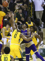 Alcorn State forward Kobe Wilson (10) is fouled by Baylor forward Flo Thamba (0) as he attempts a shot in the first half of an NCAA college basketball game, Wednesday, Dec. 30, 2020, in Waco, Texas. (AP Photo/ Jerry Larson)